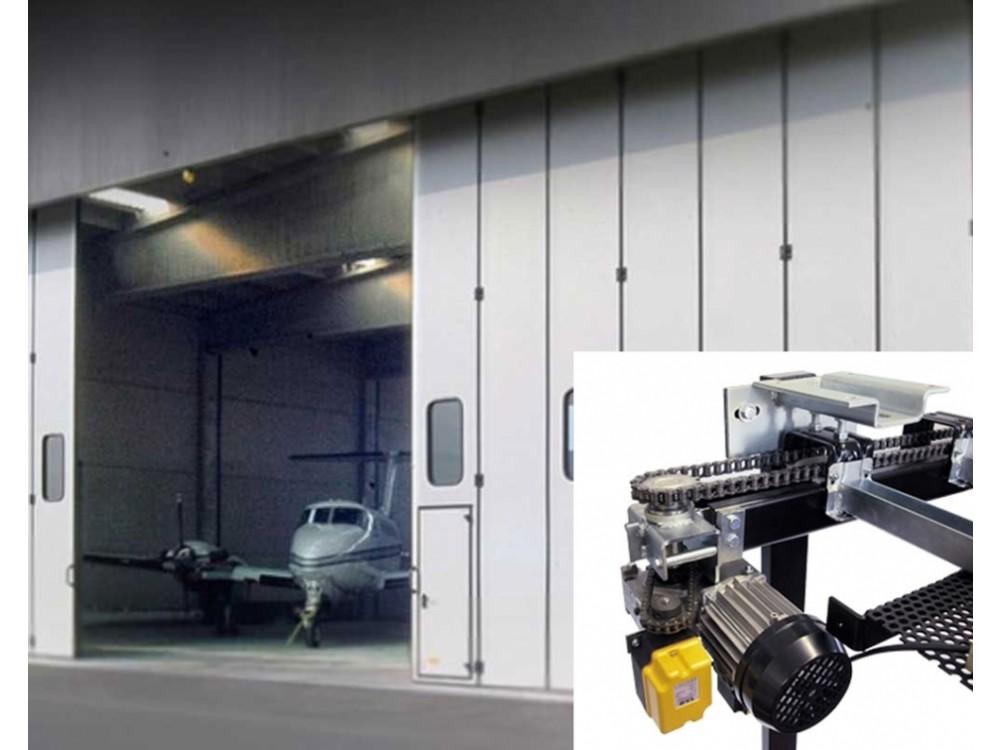 Sistema di automazione per portoni a libro di hangar