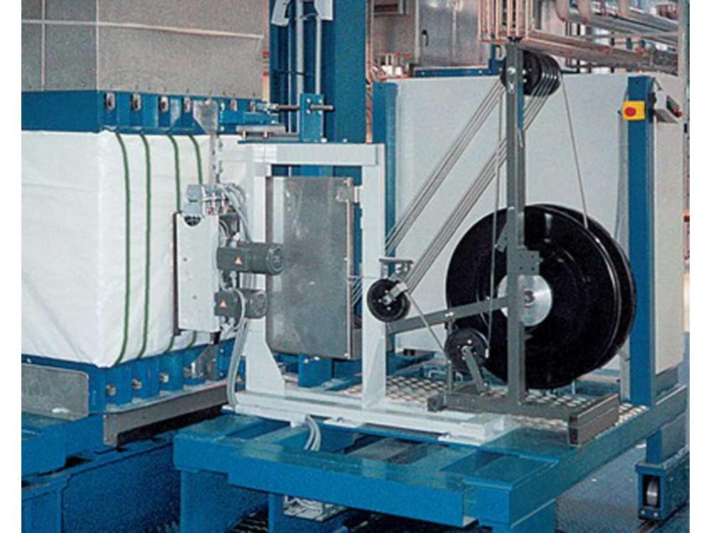 Reggiatrice per fibre tessili