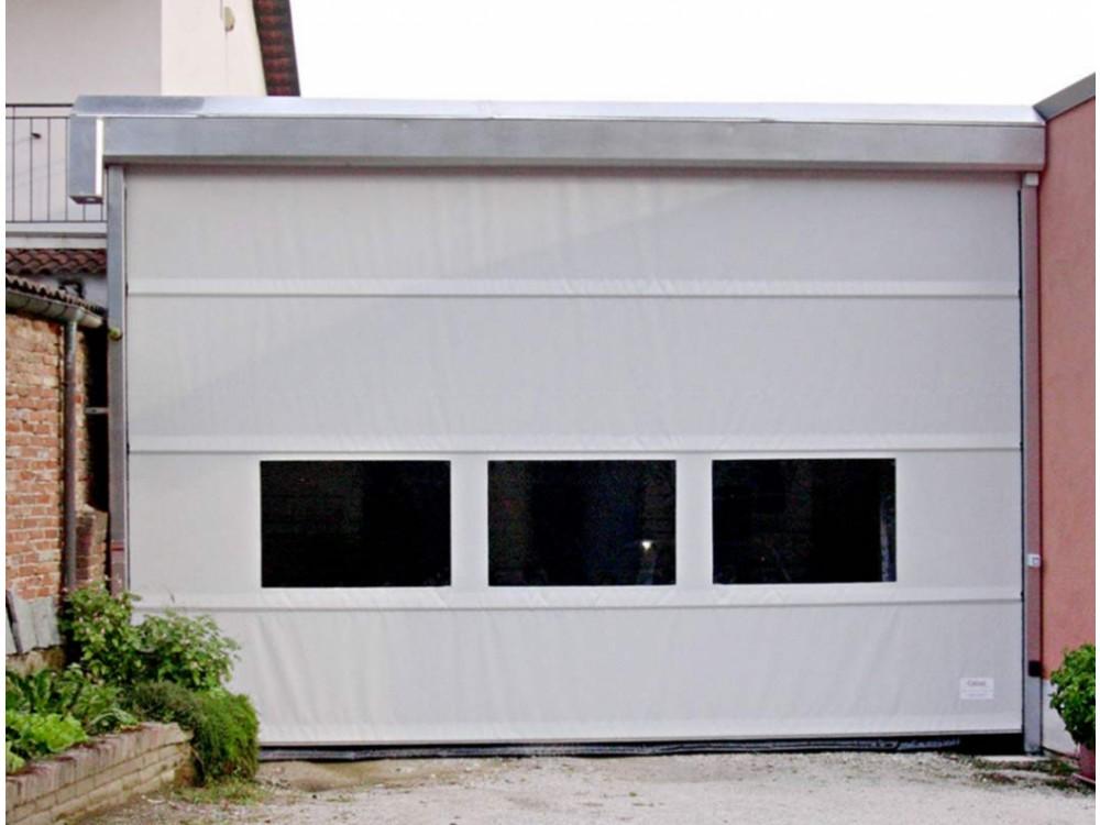Portone industriale ad avvolgimento verticale con oblò in PVC trasparente